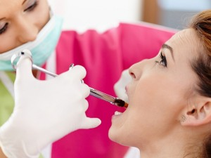 dentist-applying-local-anesthetic